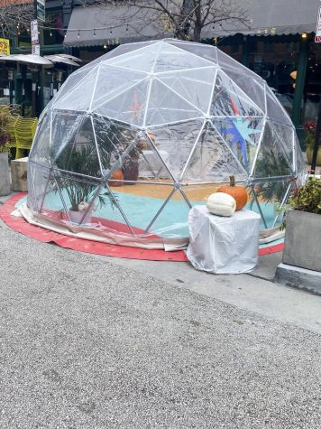 "Fulton Market in Chicago, Ill. has adapted to the ban on indoor dining by opening outdoor ""igloo"" dining areas."