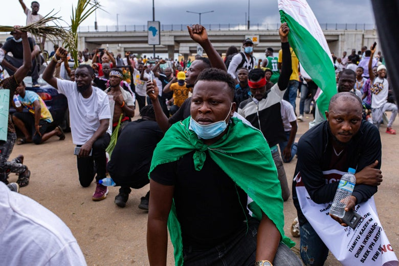 Protesters+take+a+knee+to+honor+lives+lost+to+police+brutality+during+a+protest+against+SARS+in+Lagos.%0ACourtesy+of+Slate