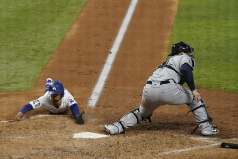 Mookie Betts slides into a victory for the Dodgers.