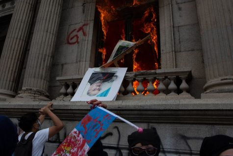 Protesters set Guatemala's Congress on fire in Guatemala City on Saturday, Nov. 21. (Courtsey of Oliver De Ros/Associated Press & The New York Times)