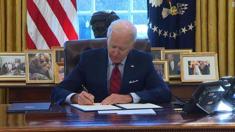 President Biden signs an executive order regarding the Affordable Care Act.