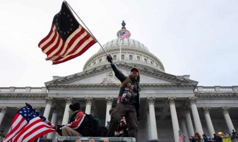 Trump supporters storm the grounds of the US Capitol on January 6. Courtesy of The Guardian
