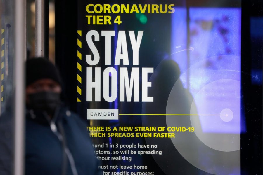 A poster in King's Cross railway station in London, England from December 2020 warns residents to stay at home due to Tier Four regulations.