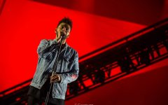 The Weeknd performs hit songs during the annual Superbowl Half Time show. (pictured above is The Weeknd performing at Lollapalooza in 2017).