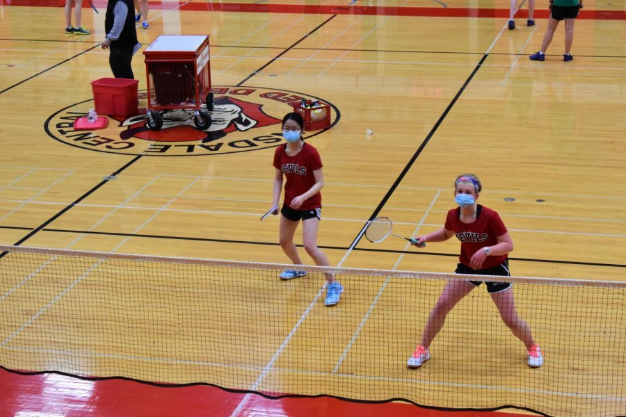 From left to right Amy Dong('22) and Louisa Brorson ('22) work together to get the ball over the net.