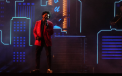 The Weeknd performs hit songs during the annual Superbowl Half Time show.