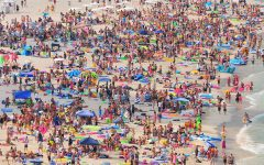 A typical beach in Miami, Fla. was covered by travelers during spring break.