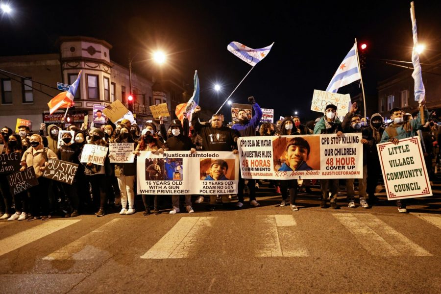 Civilians march through streets of Chicago on April 16 in protest of police brutality