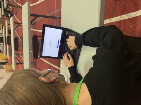 Naya Majauskas, junior, checks her grades on HAC.