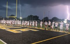 The HCHS varsity football team plays at Hinsdale South on Friday, Sept. 17, beating their team by 49-0. The weather caused the game to start an hour-and-a-half late.