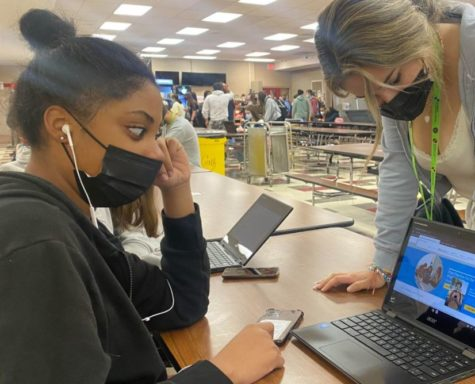Sophomores Laure Michel and Helena Tragas study before school for the PSAT, using the College Board website.